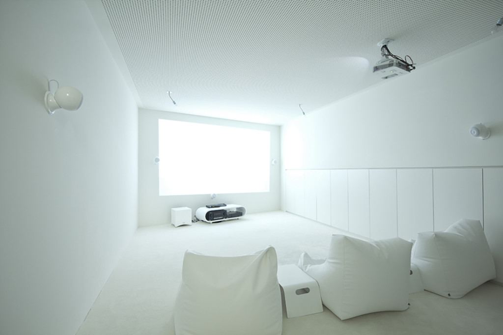 House CJ-5 basement cinema by Caramel Architekten 16