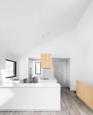 Minimalist White Kitchen with Wooden Hoods