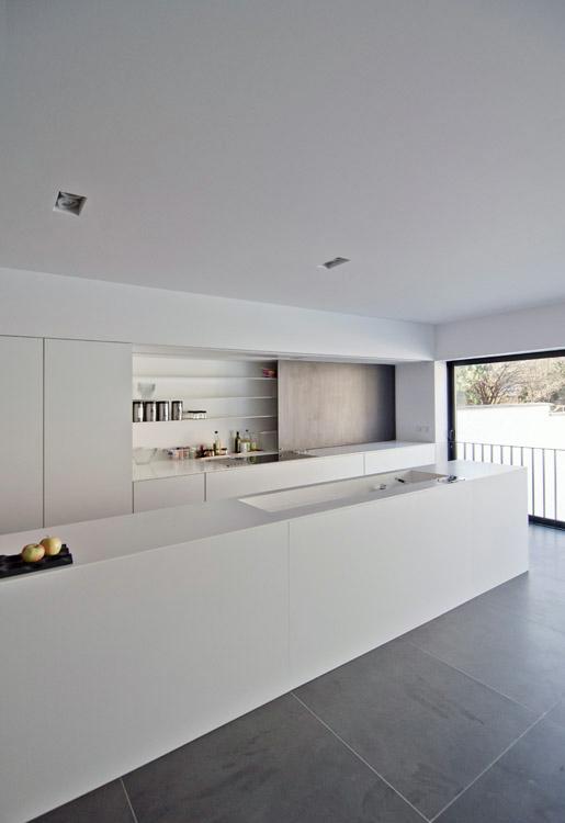 White minimalist open kitchen by bruno vanbesien architect