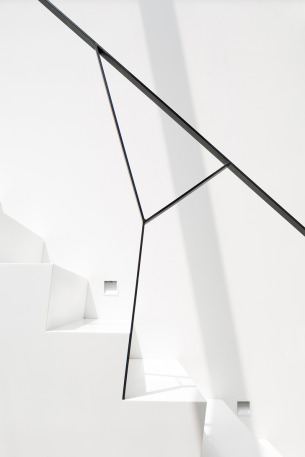 Minimalist White Staircase with Black Railings