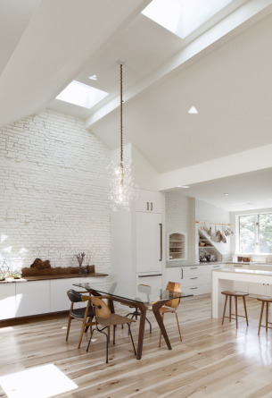 High ceiling dining room with skylight