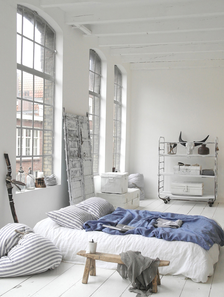 Cozy bedrooms with striped pillowcase