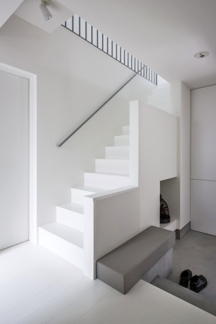 Simple White Staircase and Storage Under it