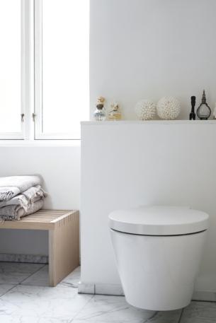 Floating Toilet in White Bathroom