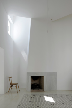 White Fireplace with Monaco-style carpet