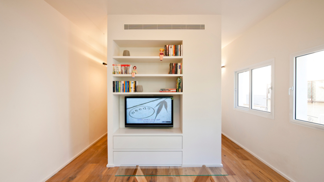 Small Apartment Conversion by SFARO Architects